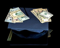 College graduation hat with money on it Stock Photography