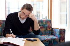 College Guy Studying Doing Homework Royalty Free Stock Image