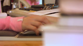 College High School Girl close up computer mouse behind stack of books stock video footage