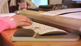 College High School Girl Types on Computer Keyboard Behind Stack of Books stock footage