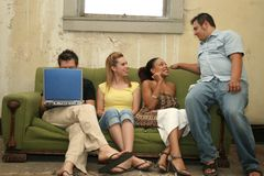 College Kids. College students in low income home on couch Stock Photo