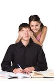 College love. Photo of a girl covering the eyes of a student boy Royalty Free Stock Images