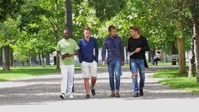 College men students walking together on campus stock footage