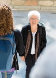 College Professor Walking to Class Outdoors stock images