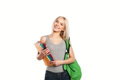 College smiling student girl with book and bag. Smiling student girl with book and bag isolated Royalty Free Stock Photo