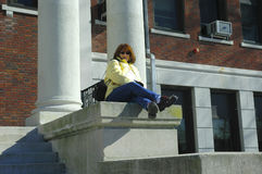 College Student 2. College Student Sitting Outside of a School / Library Royalty Free Stock Photo
