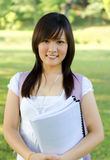 College student. Standing outside campus, green park Royalty Free Stock Images