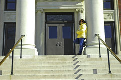 College Student 4. Woman Leaning on a Column Outside of a School / Library Stock Images