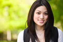 College student. A shot of a beautiful asian college student on campus royalty free stock image