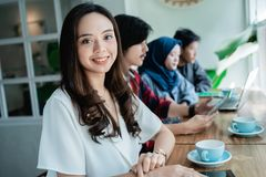 College student asian with friend in cafe. Beautiful college student asian with friend working together in cafe royalty free stock photos