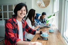 College student asian with friend in cafe. College student asian with friend working together in cafe stock image