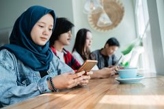 College student asian with friend in cafe. College student asian with friend working together in cafe royalty free stock photography
