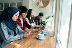 College student asian with friend in cafe. College student asian with friend working together in cafe royalty free stock photos