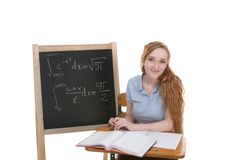 College student by blackboard studying math exam Royalty Free Stock Image