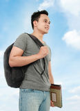 College student with book and bag Royalty Free Stock Image
