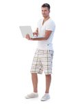College student browsing internet smiling Royalty Free Stock Photo