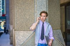 College Student calling on cell phone on street Royalty Free Stock Photo