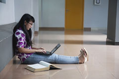 College student in campus aisle Royalty Free Stock Image