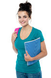 College student carrying backpack Stock Photo