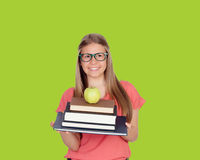 College student charged with books. On green background Royalty Free Stock Image
