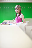 College student in a classroom. Portrait of a pretty young college student in a classroom Royalty Free Stock Photos