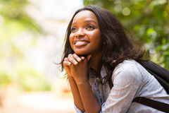 College student daydreaming. Attractive female african college student daydreaming Royalty Free Stock Photos