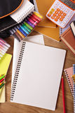 College student desk, blank writing book or notebook, copy space, vertical Royalty Free Stock Photos