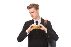 College student eating sandwich Royalty Free Stock Image
