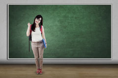 College student and empty blackboard Stock Photography