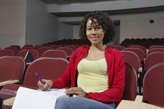 College Student In Empty Classroom Royalty Free Stock Image