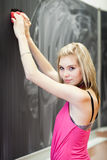 College student erasing the chalkboard Royalty Free Stock Photo