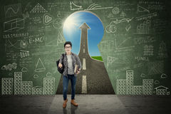 College student expressing success in keyhole Stock Images