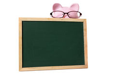 College student finance education fund concept, Piggy bank wearing glasses with small blank blackboard, isolated Royalty Free Stock Photo