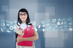 College student with futuristic interface. Female student using futuristic interface for accessing information Royalty Free Stock Photo