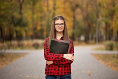 College student girl outdoors portrait. Smiling student girl royalty free stock photography