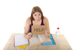 College student girl studying for university exam worried in stress asking for help Stock Photo