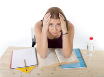 College student girl studying for university exam worried in stress feeling tired and test pressure Stock Image