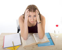 College student girl studying for university exam worried in stress feeling tired and test pressure royalty free stock images