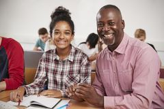 College Student Has Individual Tuition From Teacher In Classroom stock photo