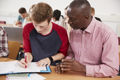College Student Has Individual Tuition From Teacher In Classroom stock image