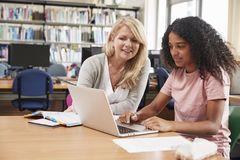 College Student Has Individual Tuition From Teacher In Library royalty free stock photos