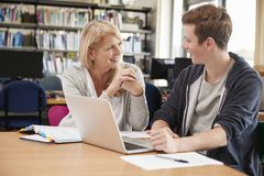 College Student Has Individual Tuition From Teacher In Library stock images