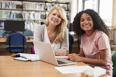 College Student Has Individual Tuition From Teacher In Library stock photos