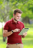 College student having fun playing a tablet Stock Image
