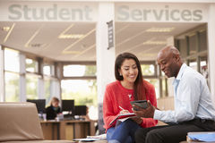 College Student Having Meeting With Tutor To Discuss Work stock image