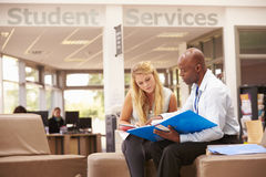 College Student Having Meeting With Tutor To Discuss Work Royalty Free Stock Photo