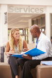 College Student Having Meeting With Tutor To Discuss Work Royalty Free Stock Images