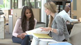 College Student Having Meeting With Tutor To Discuss Work stock video
