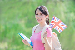 College student hold British flag. Happy college student girl hold British flag with nature white background, asian Stock Photos