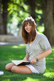 College student holding book Stock Photography